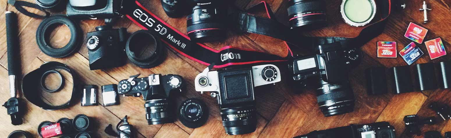 pictures of cameras, lenses, and other photography accessories