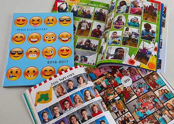 one closed yearbook and two open yearbooks, emoji yearbook cover with two open yearbooks